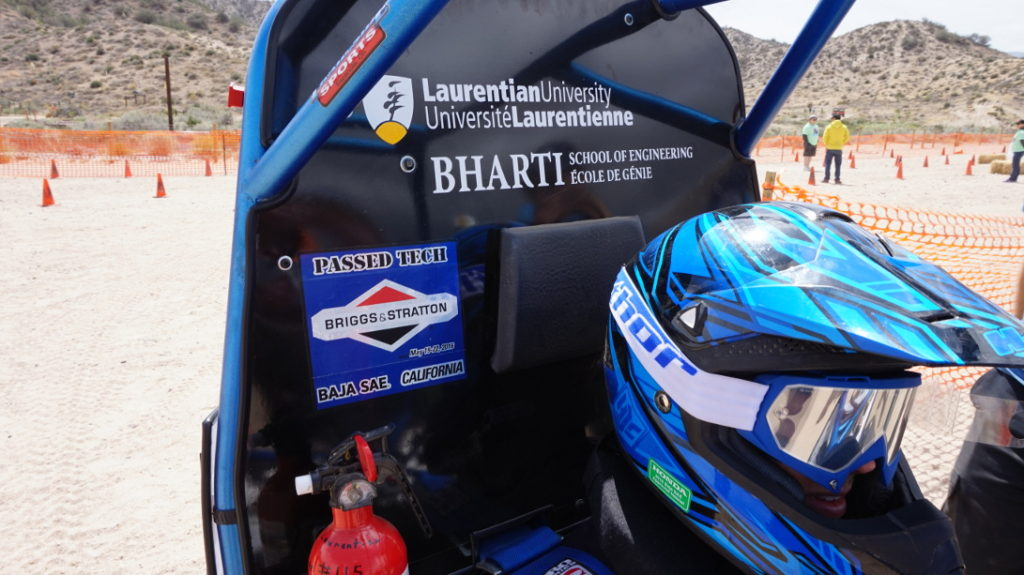 Those three blue stickers —Briggs & Straton, Passed Tech, and Baja SAE California— indicate a vehicle that has passed the engine check, technical inspection, and the dynamic brake testing. It is ready to compete.